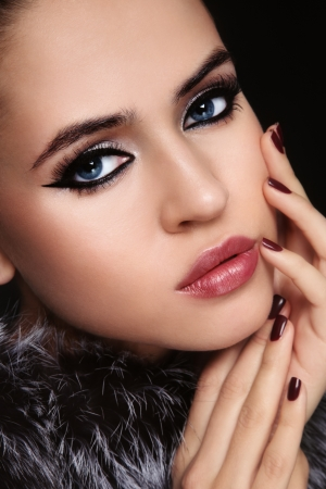 Close-up portrait of young beautiful woman with trendy make-up photo