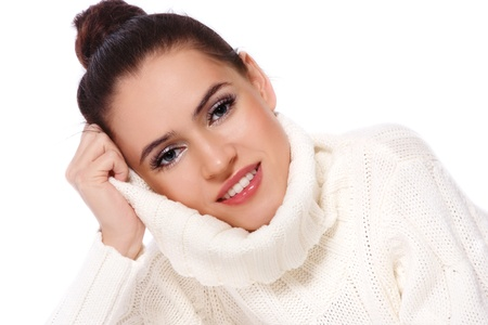 informal clothes: Young beautiful happy smiling girl in handmade pullover over white background