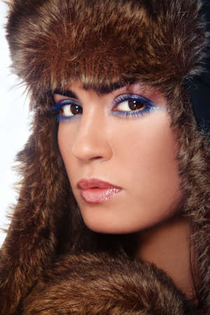 Close-up portrait of young beautiful woman with stylish make-up in fur hat Stock Photo - 11260906