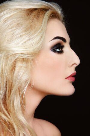 Profile of young beautiful blond woman with stylish make-up photo
