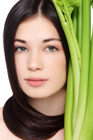 Portrait of young fresh beautiful healthy woman with clear make-up and green celery photo