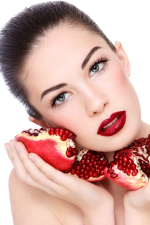 pomegranates: Portrait of young beautiful woman with pomegranates in her hands, on white background