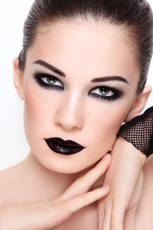 Close-up portrait of young beautiful woman wiith stylish black make-up Stock Photo - 11448613
