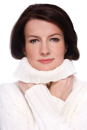 groomed: Portrait of attractive groomed healthy happy middle-aged woman in knitted pullover, over white background Stock Photo