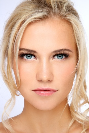 pretty blonde girl: Close-up portrait of young beautiful blond girl with clear make-up Stock Photo