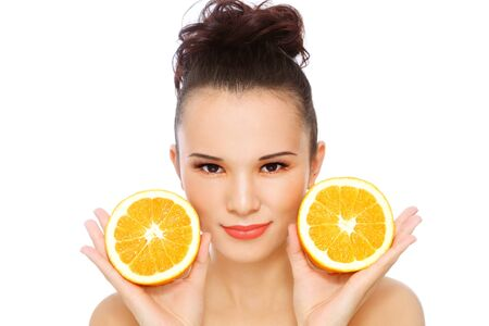 clear skin: Young beautiful healthy fresh happy asian girl with oranges in her hands, over white background Stock Photo