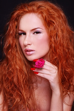 Portrait of young beautiful sexy woman with fiery red curly hair photo