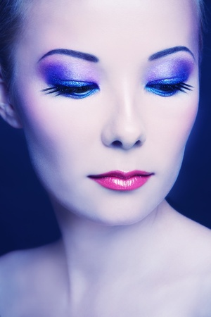 entice: Portrait of young beautiful asian girl with stylish make-up