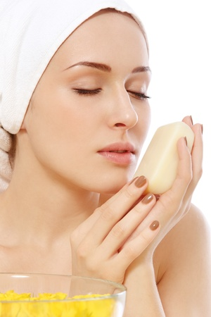 luscious: Young beautiful woman with luscious handmade soap in her hands