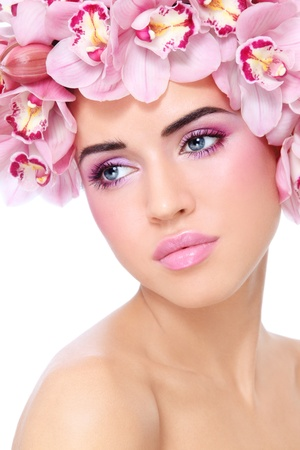 Young beautiful tanned sexy woman with fresh make-up and orchids in her hair, on white background Stock Photo - 12325234