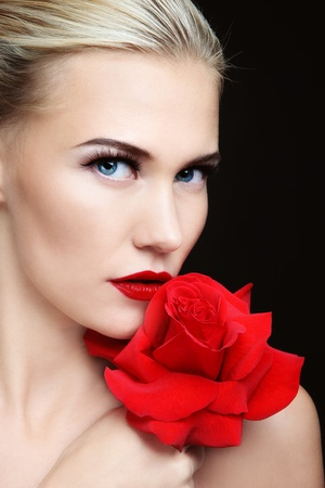 Close-up portrait of young beautiful sexy blond woman with red rose Stock Photo - 12325211