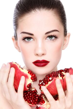ageing: Portrait of young beautiful woman with pomegranates in her hands, on white background