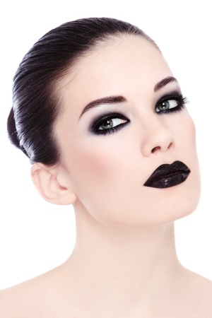 Portrait of young beautiful woman with stylish black make-up over white background