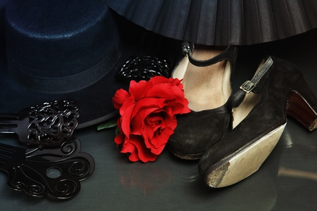 carmen: Still-life with bright flamenco accessories. Shoes, hair flower, fan, combs and hat