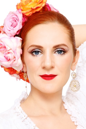 carmen: Portrait of young attractive flamenco dancer with roses in her hair, on white background Stock Photo