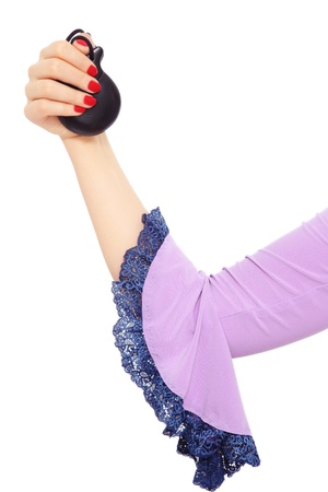 Woman's hand with castanets over white background Stock Photo - 12325279