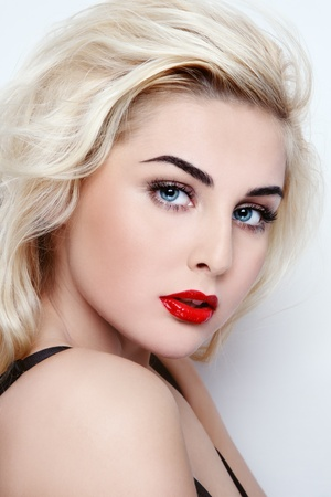 Portrait of young beautiful sexy blond girl with red lipstick photo