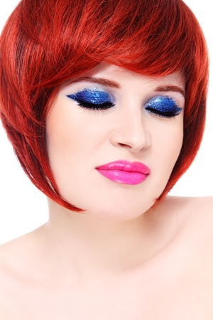 wig: Portrait of young beautiful redhead woman with fancy sparkly make-up