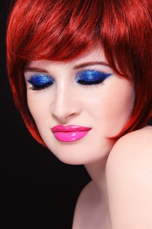 glamour makeup: Portrait of young beautiful redhead woman with fancy sparkly make-up
