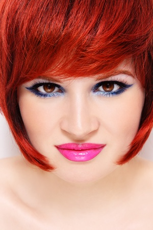Close-up portrait of young beautiful redhead woman with fancy sparkly make-up  photo