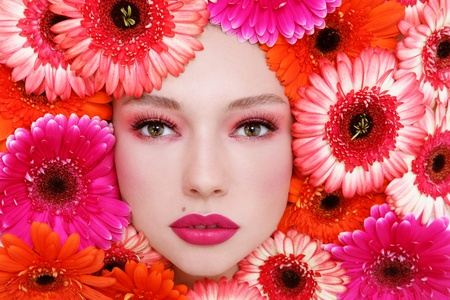 Horizontal portrait of beautiful woman with stylish make-up and bright flowers around her face Stock Photo - 13425977