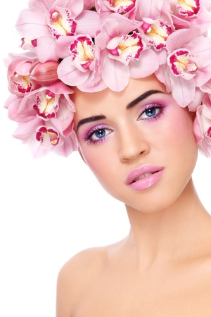 Portrait of young beautiful tanned sexy woman with fresh make-up and orchids in her hair over white background Stock Photo - 13425949