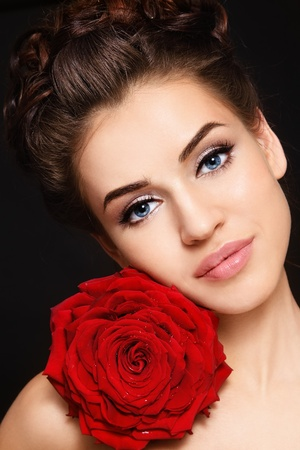 Portrait of young beautiful stylish woman with gorgeous red rose photo