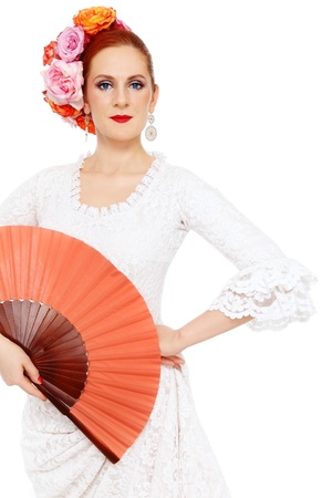 Young attractive flamenco dancer with roses in her hair over white background Stock Photo - 13425950
