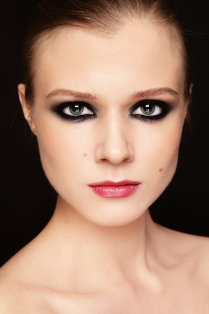 smoky eyes: Close-up portrait of young beautiful girl with smoky eyes