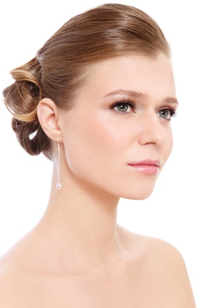 Young beautiful blond girl with prom make-up and hairdo, over white background Stock Photo - 13425940