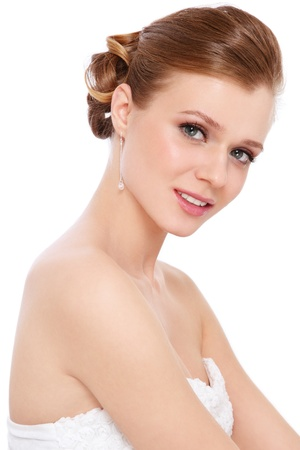 Young beautiful bride with clear make-up and classic hairdo, over white background Stock Photo - 13425953