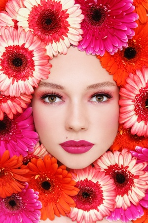 Portrait of beautiful woman with stylish make-up and bright flowers around her face Stock Photo - 13425981
