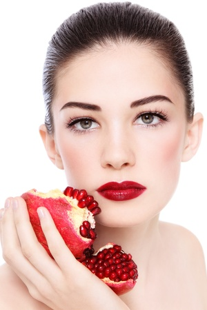 pomegranates: Portrait of young beautiful woman with pomegranates in her hand, on white background
