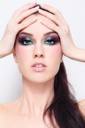 Young beautiful woman with fancy colorful make-up Stock Photo - 13516383