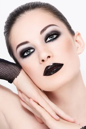 goth girl: Portrait of young beautiful woman wiith stylish black make-up