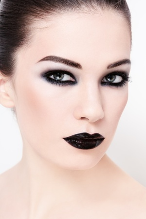 Portrait of young beautiful woman wiith stylish black make-up photo
