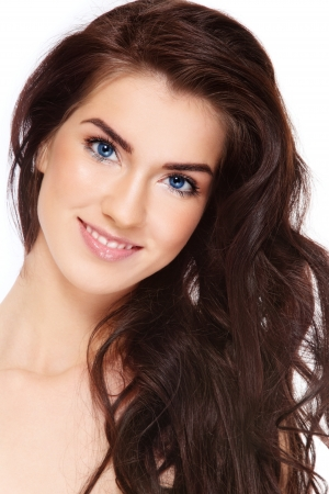 Young beautiful happy smiling woman with long dark hair