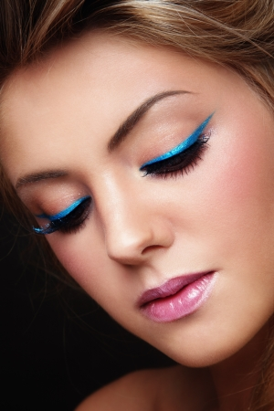 Close-up portrait of young beautiful girl with stylish make-up  photo