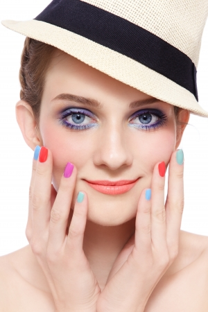 Portrait of young pretty smiling girl with bright make-up and colorful nail polish, on white background photo