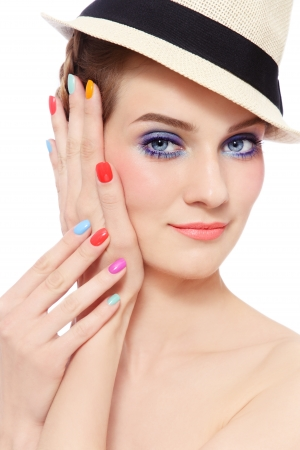 Portrait of young pretty smiling girl with bright make-up and colorful nail polish, on white background Stock Photo