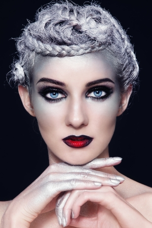 Portrait of young beautiful woman with stylish fancy make-up and silver hair