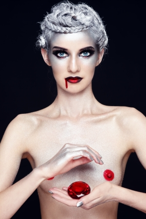 Young slim sexy naked woman vampire with silver hair and bloody mouth Stock Photo - 14489617