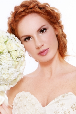 beautiful redhead: Young beautiful redhead bride with clear make-up and fancy braids Stock Photo