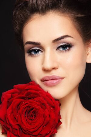 Portrait of young beautiful stylish woman with gorgeous red rose Stock Photo - 14497638