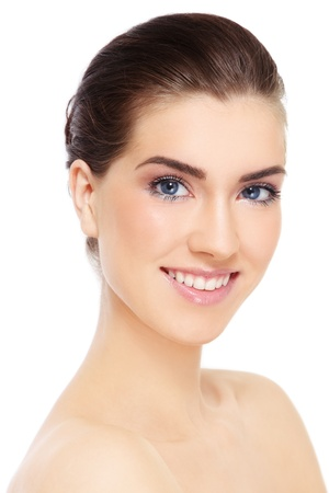 Portrait of young beautiful smiling healthy woman over white background photo