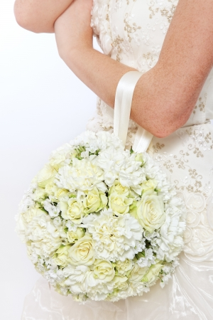bridal bouquet: Fancy round bridal bouquet with white flowers