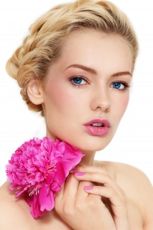 Young beautiful healthy blond girl with pink flower on white background
