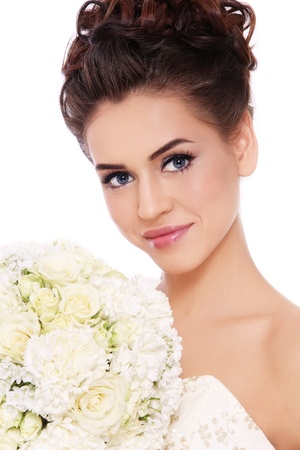 bridal bouquet: Portrait of young beautiful smiling bride with stylish make-up and hairdo over white background