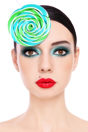 beauty spot: Close-up portrait of young beautiful woman with stylish make-up and fancy lollipop hat