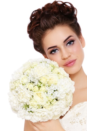 bridal bouquet: Portrait of young beautiful bride with stylish make-up and hairdo over white background Stock Photo